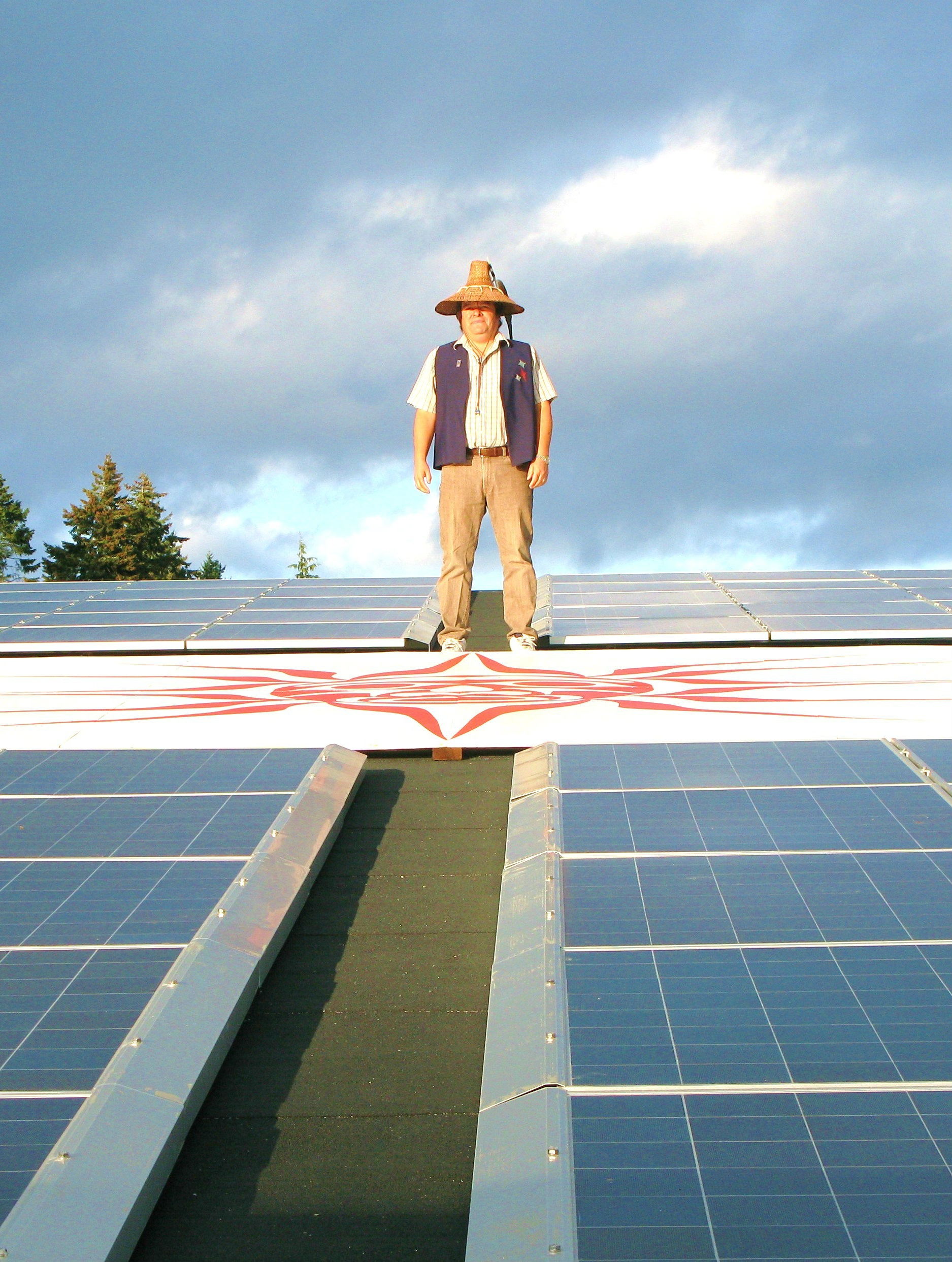 Chief Gordon Planes of T'Souke First Nation in B.C. stands proud amongst the solar PV array his community installed.